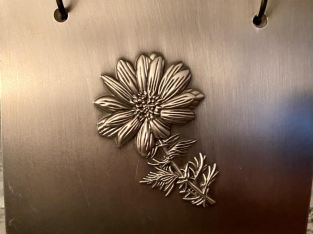 Metal picture album with a metal flower on it