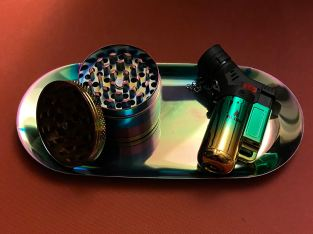 Metal rolling tray, matching grinder and torch lighter.