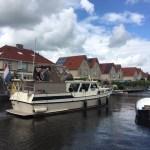 Schilderen romp en opbouw Lauwersmeerkruiser 12,50m uit 1978