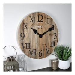Designed with solid wood planks and a vintage look, this wall clock makes a great addition to any home with a farmhouse aesthetic. Large hands and roman and Arabic numerals offer an easy-to-read design.  Solid wood planks offer rustic farmhouse style.  Quartz movement for precise timekeeping.  Face displays Arabic and Roman numerals with large hands to help you check the time with just a glance.  Requires 1 AA battery. Batteries are sold separately.