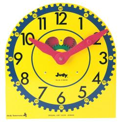 Judy Clock makes learning to tell time simple and fun for children. Visible functioning gears maintain correct hour hand and minute hand relationships. Easy-to-read numerals show elapsed time in five-minute intervals. The permanently assembled wood clock includes a handy metal stand and Teaching Guide. Makes learning and telling time simple and fun!  Visible functioning gears maintain correct hour hand and minute hand relationships.  Permanently assembled wood clock is 12 3/4in. x 13 1/2in..  Handy metal stand and Teaching Guide included.