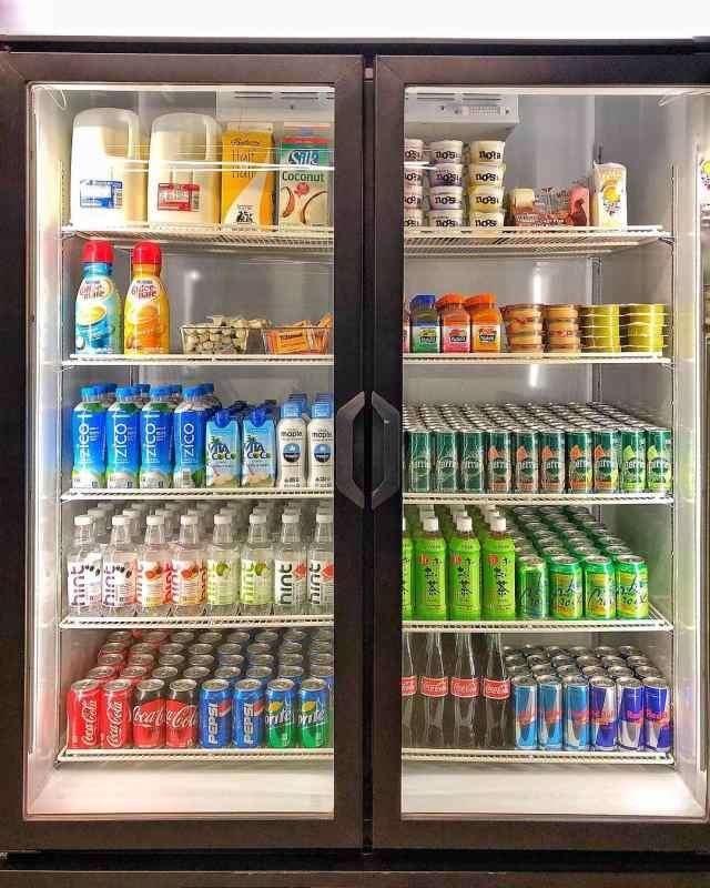 Fully stocked office break room fridge by Office Libations