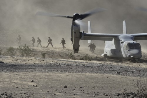 U.S. Marines exit a MV-22 Osprey during an embassy reinforcement exercise at a training area near Camp Lemonnier, Djibouti, Oct. 26, 2013.