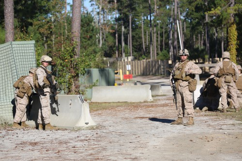 U.S. Marines defend a simulated embassy at Marine Corps Base Camp Lejeune, N.C., Oct. 24, 2013. Marine Corps photo