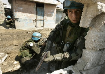 Brazilian troops take positions during an operation in a Haitian slum. U.N. photo