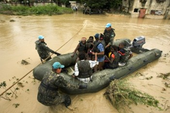 Brazilian peacekeepers evacuate flooding victims after after tropical storm Noel in 2007. U.N. photo