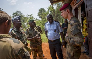 "A french captain from the ""1er régiment de hussards parachutistes"" meets local authorities in Gamboula, CAR, February 18th 2014."