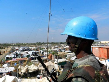 A UN Peacekeeper patrols and protects civilians in the UN base in Malakal, South Sudan (Photo: UNMISS).