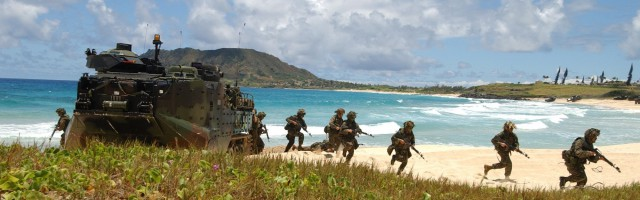 U.S. Marines assigned to 3rd Battalion, 3rd Marine Regiment disembark Amphibious Assault Vehicles during a mechanized raid in support of exercise Rim of the Pacific (RIMPAC) 2004, Marine Corps Base Hawaii, July 18, 2004 (Photo: Photographer's Mate 1st Class Jane West / US Navy).