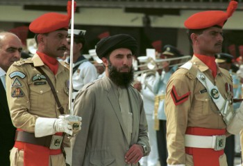 Gulbuddin Hekmatyar (center) passes in front of an honor guard in the Afghan capital of Kabul, Afghanistan, after being sworn in as prime minister, June 26, 1996, ending four years of bitter fighting among U.S. backed rebels who took control of Kabul from the communist regime. Hekmatyar today is a U.S.-declared terrorist in hiding fighting international forces in Afghanistan. His representatives have opened talks with President Hamid Karzai's political opponents, as well as Karzai.