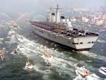 HMS Invincible, a British light aircraft carrier, returns from Falklands War