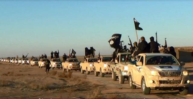 This file image posted on a militant website on Jan. 7, 2014 shows a convoy of vehicles and ISIS fighters in Iraq's Anbar Province. With pictures like this - and also with the horrible video of the murder of James Wright Foley - ISIS, like other terrorist groups, target the people through the possibilities of modern communication.