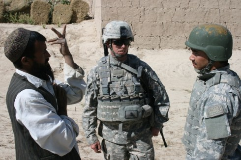Staff Sgt. Ashley Hess, 2nd Platoon, Able Troop, 3rd Squadron, 71st Cavalry interviews farmer, Logar, Oct. 14, 2009.