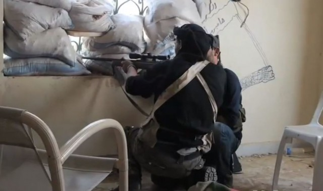 Syrian sniper in Aleppo, Syria in mid-2013. Youtube screencap/Wikipedia photo
