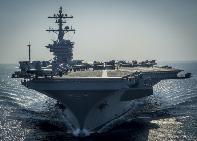 Beginning of December 2014, the Nimitz-class aircraft carrier USS Carl Vinson (CVN 70) prepares for flight operations in the Arabian Gulf. Carl Vinson is deployed in the U.S. 5th Fleet area of responsibility supporting Operation Inherent Resolve, strike operations in Iraq and Syria as directed, maritime security operations, and theater security cooperation efforts in the region (Photo: Mass Communication Specialist 2nd Class Alex King, U.S. Navy).