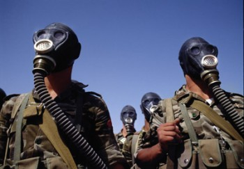Syrian troops in chemical-weapons gear before 1991's Gulf War (Photo: Tom Stoddart / Getty Images).