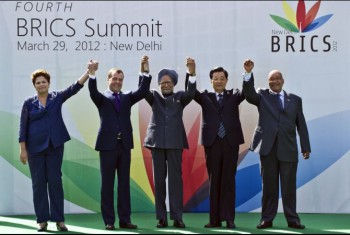 Heads of the BRICS countries (L to R) President Dilma Rousseff of Brazil, Russian President Dimitry Medvedev, Indian Prime Minister Manmohan Singh, Chinese President Hu Jintao and President Jacob Zuma of South Africa pose prior to the BRICS summit in New Delhi on March 29, 2012. (Phot: Prakash Singh / AFP / Getty Images).