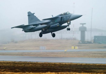 One of the Swedish Air Force'€™s JAS 39 Gripen jet fighter aircraft takes off from Kallinge southern Sweden, on Saturday April 2, 2011.  Three of Sweden's new warplanes left from Kallinge en route to the island of Sardinia, off west Italy on Saturday to join the NATO-led operation in Libya. (Photo: Patric Soderstrom, AP)