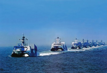 Several People's Liberation Army Navy Houbei missile boats.