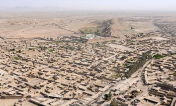 An aerial view of Spin Boldak, Afghanistan, taken from a Blackhawk helicopter, April 4, 2011. Spin Boldak sits near the Afghanistan-Pakistan border in southern Kandahar province. (Photo: Spc. Jonathan W. Thomas, 16th Mobile Public Affairs Detachment).