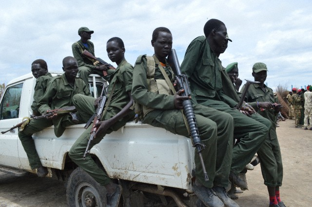 South Sudan Democratic Army (SSDA) Cobra faction soldiers stand guard as You You visits. South Sudanese government and the SSDM under David Yau Yau South signed a final peace deal in May 9th, 2014 in Addis Ababa.