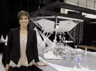 Producer Nicole Feld with the set concept model for the show