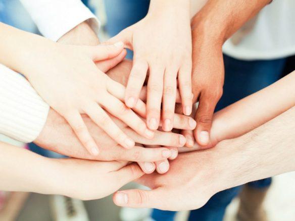 hands in dental team