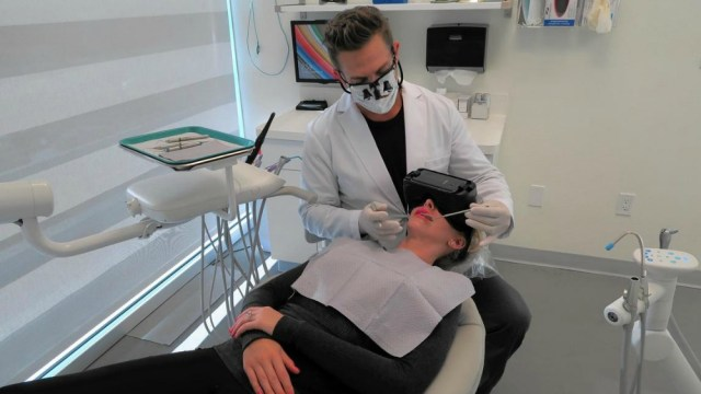 dental patient wearing virtual reality goggles during visit