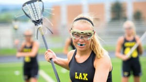 girl lacrosse player with mouthguard