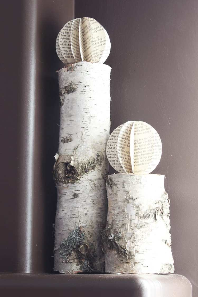 The more refined look of these book page paper orbs goes perfectly with rustic birch logs.