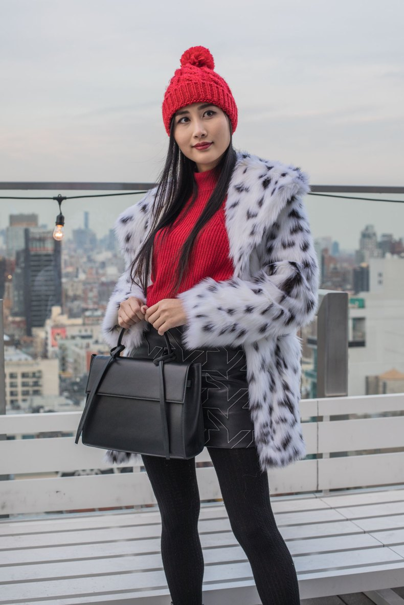 How to Achieve a Stylish Winter Outfit in NYC - Red Pom Pom Beanie, Cable Knit Tights, Leather Skirt, Red Sweater, Spotted Fur Coat, Black XNihilo Bank Bag, Asian Blogger, NYC Fashion Blogger | in NYC | Ofleatherandlace.com