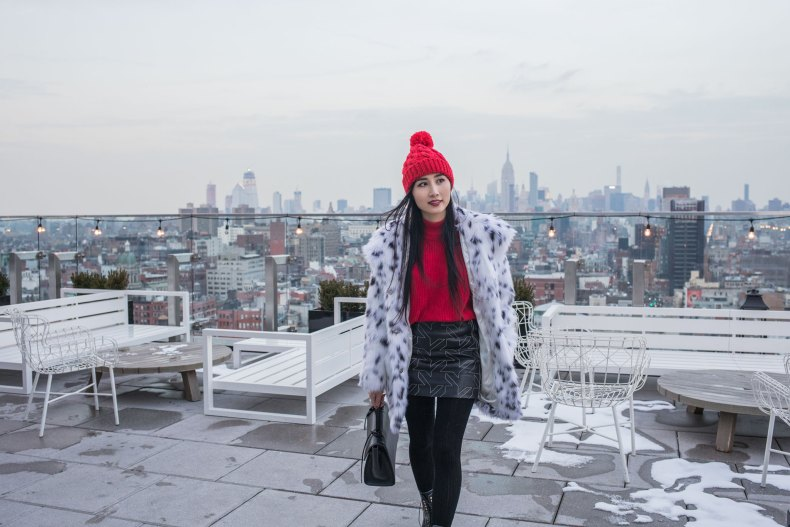 How to Achieve a Stylish Winter Outfit in NYC - Red Pom Pom Beanie, Cable Knit Tights, Leather Skirt, Red Knit, Spotted Fur Coat, Black XNihilo Bank Bag, Asian Blogger, NYC Fashion Blogger | in NYC | Ofleatherandlace.com