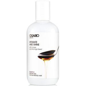 bottle of ogario hydrate and shine shampoo on white background