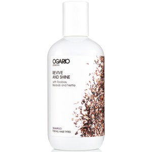 bottle of ogario revive and shine shampoo on white background