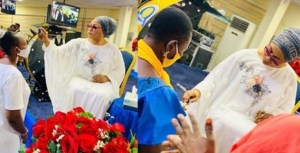 Billionaire Businesswoman, Folorunso Alakija pictured anointing her church members with olive oil (Photos)