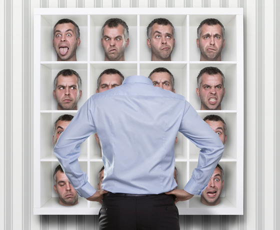 "Man selecting from different facial expressions, illustrating the advice ""get in touch with your feelings."""