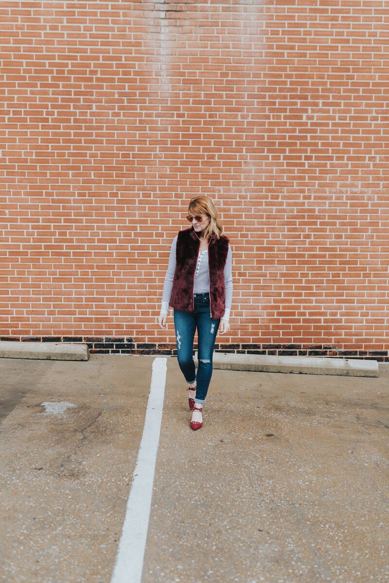 long sleeve henley tee paired with faux fur vest