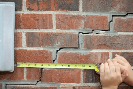 exterior brick wall with tape measure