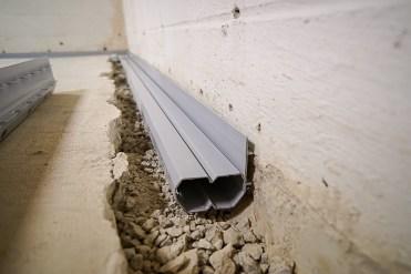 Installed basement gutter
