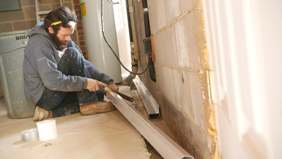 installing basement drainage and waterproofing
