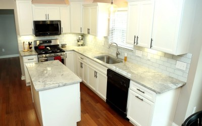 Super White granite with Hampton cabinets and new hardwood flooring!