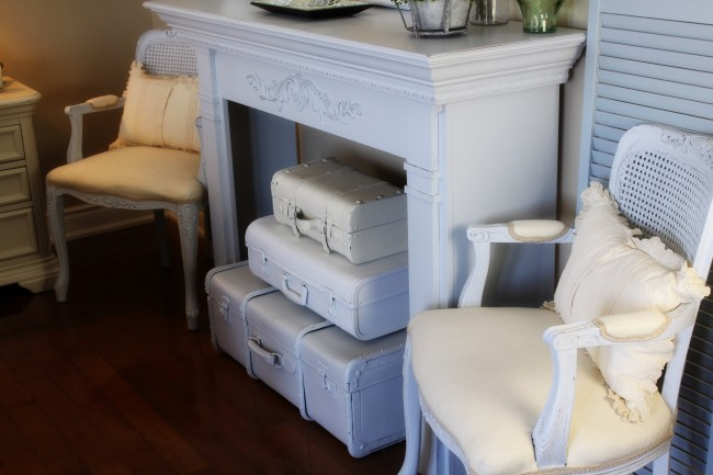 Vintage Suitcase Fireplace Decor included in these 20 DIY Vintage Suitcase Projects and Repurposed Suitcases. Create unique home decor using repurposed old suitcases! | OHMY-CREATIVE.COM