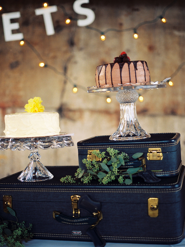 Vintage Suitcase Party or Wedding Cake Riser Display included in these 20 DIY Vintage Suitcase Projects and Repurposed Suitcases. Create unique home decor using repurposed old suitcases! | OHMY-CREATIVE.COM