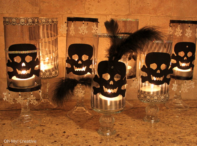 These Glam Halloween Skull Candle Holders are a perfect dollar store Halloween craft! With a few additional Halloween trims you can add a spooktacular glow to any party! | OHMY-CREATIVE.COM