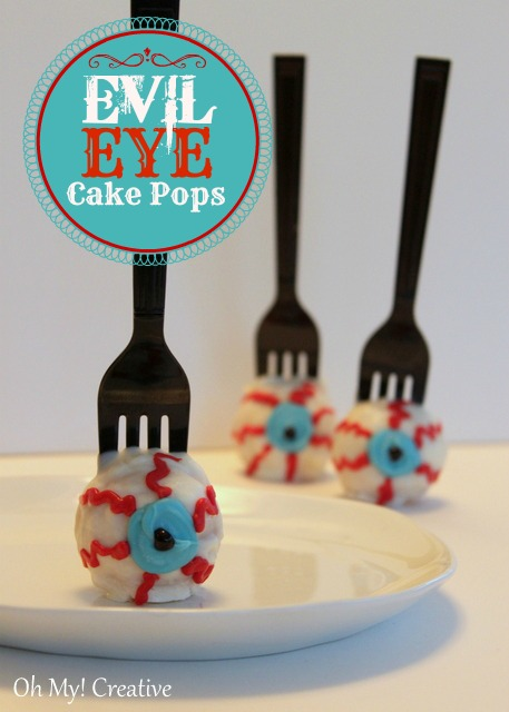 Fun evil eye cake pops perfect for Halloween! Create a unique detail by using a fork instead of a pop stick!  OHMY-CREATIVE.COM