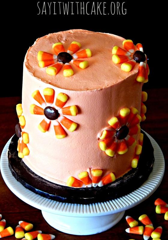Candy Corn Cake 15 Candy Corn Desserts & Crafts - OhMy-Creative.com | Candy Corn Cupcakes | Candy Corn Desserts | Candy Corn Crafts | Halloween Rice Krispie Treats | Halloween Treats | Candy Corn Marshmallows | Candy Corn Recipe