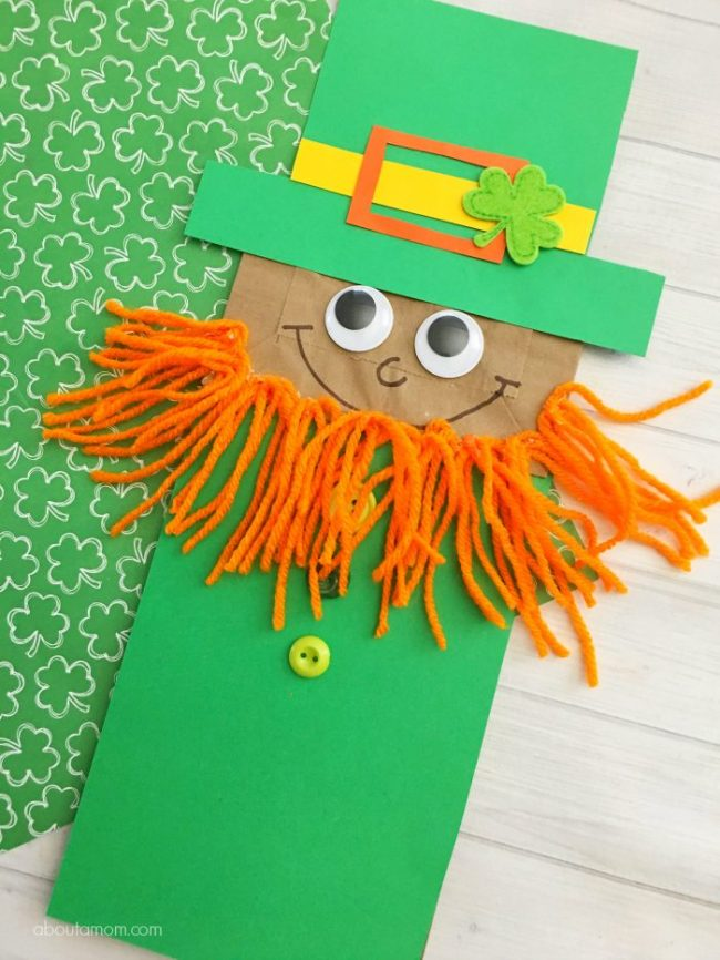 Leprechaun paper bag craft with orange yard beard also makes a great puppet.