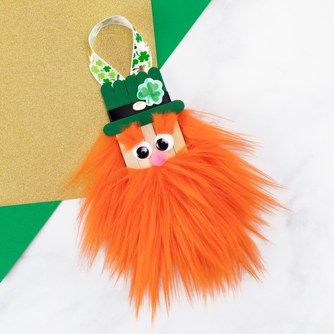 Popsicle Stick Leprechaun Craft with a orange fun fur beard.