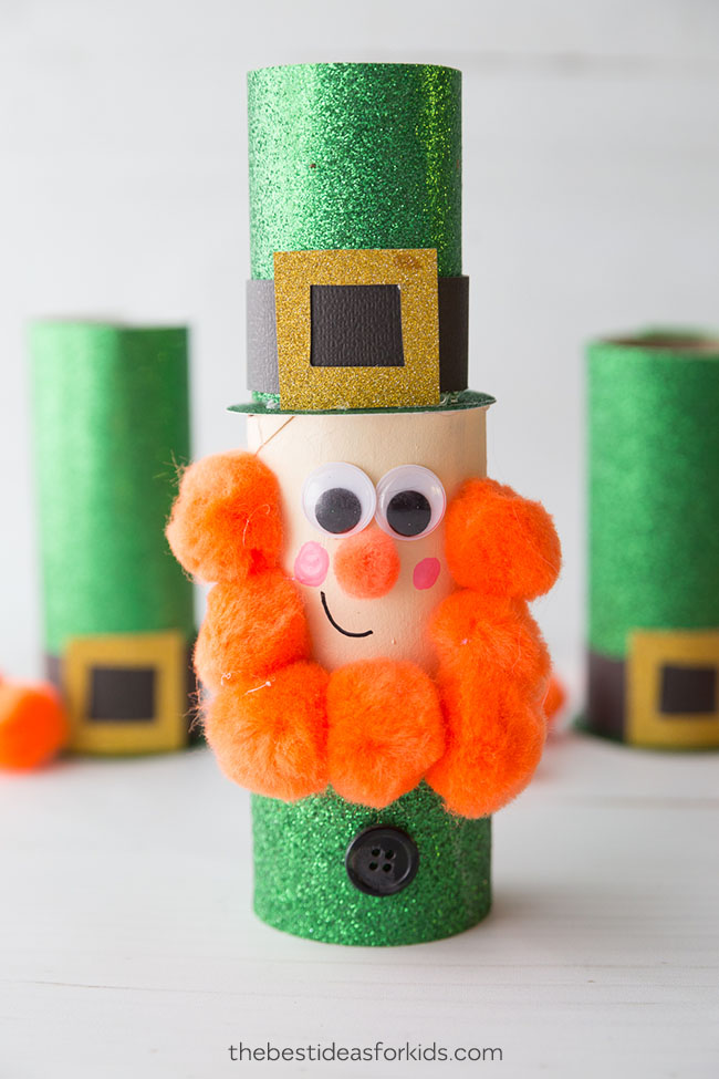 Toilet Paper Roll Leprechaun Craft with an orange pom pom beard.