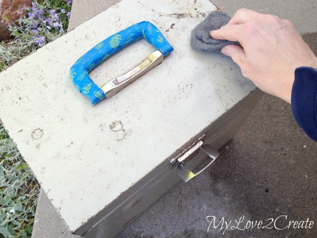 using steel wool to clean metal box